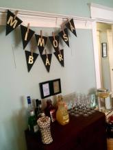 The mimosa bar! I made the bunting with this really neat paper-cutting tool that my Mum and I found at Michael's. It ended up looking really great!